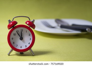 Time to eat concept,  clock on plate