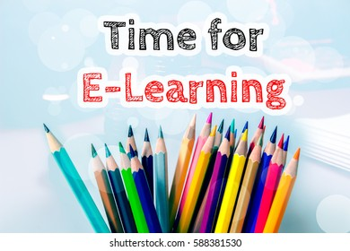 Time for E-Learning, text message on blue background with color pencil