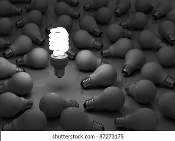 It's time for energy saving light bulb, one glowing compact fluorescent light bulb standing out from the unlit incandescent light bulbs