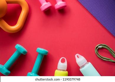 Time for exercising sport equipment, dumbbell, kettlebell and yoga mat background
