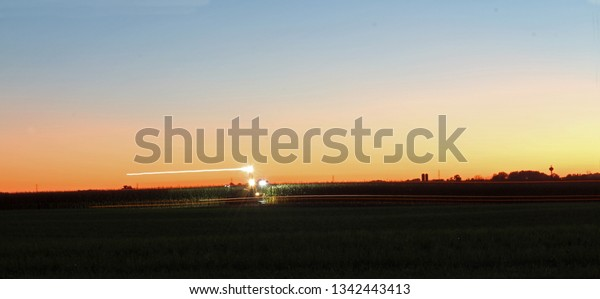 time-exposure-farmer-picking-corn-600w-1