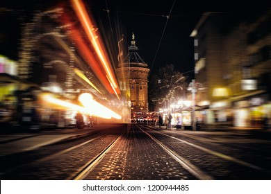 Time Exposure train traffic light night Mannheim street urban public transport city christmas holiday shopping water tower