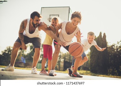 Time for family basketball.  Family at basket playground.