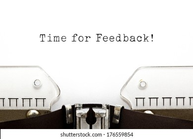 Time for Feedback printed on an old typewriter.