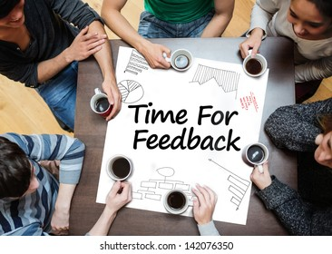 Time for feedback written on a poster with drawings of charts during a brainstorm