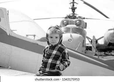 Its time to fly. Little kid have summer vacation. Cute boy child on vacation trip. Little child at helicopter field. Helicopter tour and travel. Air travel. Enjoying summer travel. Travelling by air.