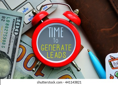 Time to generate leads. Sign on red clocks with cash and coins on background