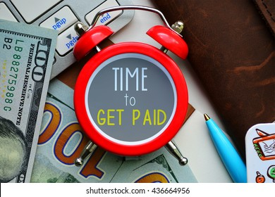 Time to get paid. sign on red clock with cash