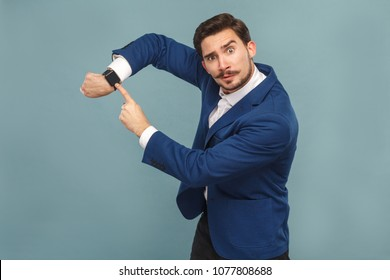 Time is gone! Boss showing watch bad manager. Business people concept, richly and success. Indoor, studio shot on light blue background