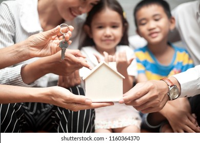 Time of happiness family with real estate agent. Buying a new house. or Real Estate agent offer home ownership and life insurance to young family,Start a family life, stability, future of children.