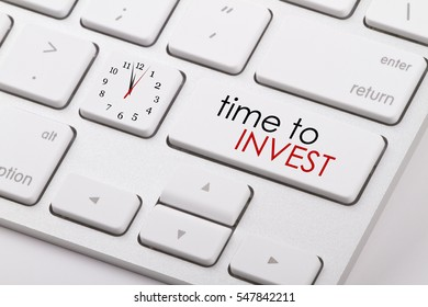 Time to invest word written on computer keyboard.