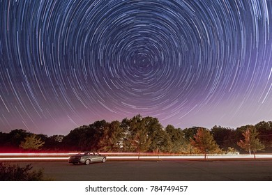 A time lapse exposure showing star trails over Broemmelsiek Park, St Charles County Parks and Recreation Areas, Near St Louis, Missouri, USA