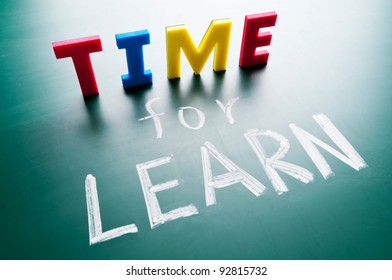 Time for learn, colorful words on blackboard.