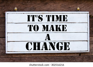 It's time to make a Change Inspirational message written on vintage wooden board. Motivation concept image