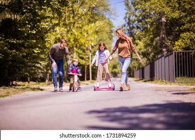 It's time to make summer fun. Parents spending time with their children outside.