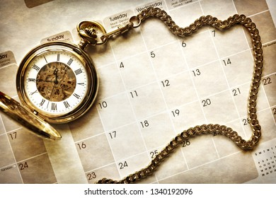 Time management, gold pocket watch on blank calendar background