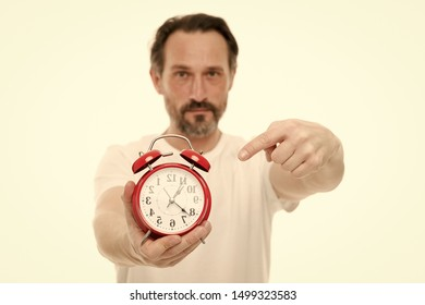 Time management. Personal schedule and daily regime. Alarm clock morning time. Time management skills. Man bearded mature guy hold clock isolated on white. Man with beard check what time is it.