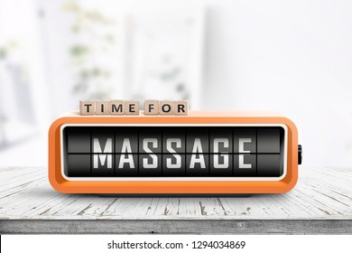 Time for massage message on a retro clock in a bright room on a white desk