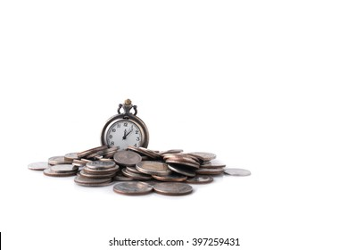 Time is money concept. Coins and an old pocket-watch. Selective focus.