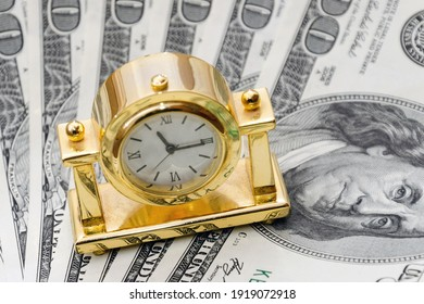 Time is money. Gold watch on 100 dollar bills. The concept of the transience of time