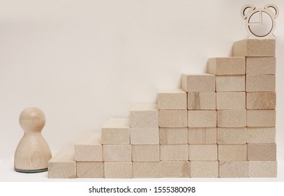 Time is money idea.  time concept with business man trying to outrun time.  Make things better - Improvement Concept. wooden figure -  man climbing the steps to success in image over white background