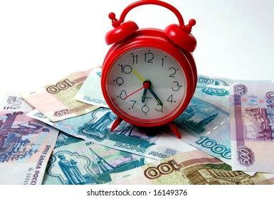 Time - a money. The Paper russian bills and red watch. The Concept : correct use of time.
