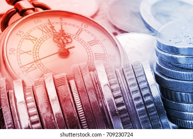 Time is money, time value of money concept : Coins and vintage brass pocket watch, idea of time which is a valuable commodity or resource and it's better to do work or things as quickly as possible.