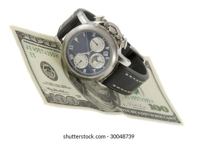 Time is money. Watch and hundred dollars banknote isolated over white background