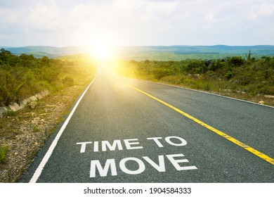 Time to move inscription on straight road. Motivational inscription on the road going forward. The beginning of a new path. A conceptual photo of the path leading to a bright future.