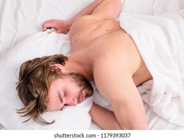 Time for nap. Let your body feel comfortable. Man handsome guy sleep nap on bed top view. Deep sleep concept. Comfortable mattress and pillows. Man sleepy unshaven bearded face has rest.