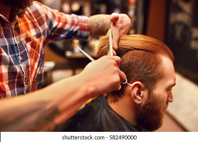 Time for a new hairdo. Handsome young bearded man came to the barber for a haircut. hipster style. the concept of fashion and beauty.