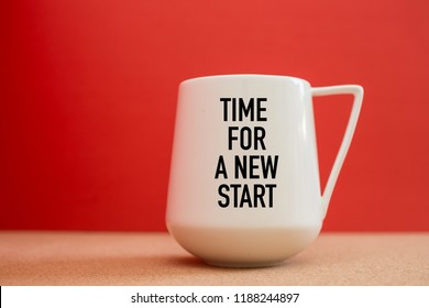 Time For a New Start on white cup against red background