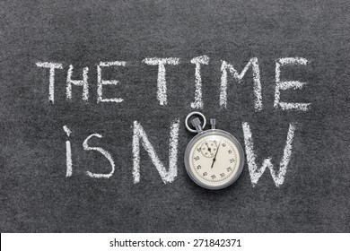 the time is now phrase handwritten on chalkboard with vintage precise stopwatch used instead of O