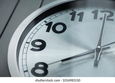 the time on the clock 8:00 (20:00) white clock on a gray background, the working day, the end of the day