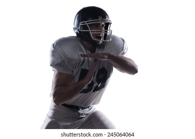 Time out requirement.  American football player screaming and showing time out while standing against white background