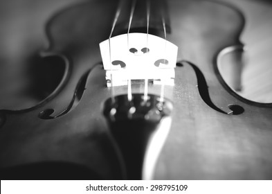 """""""time to practice violin"""" violin in vintage style on wood background black and white color tone style"""