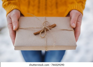 Time for presents - Close up shot of female hands holding a small gift wrapped with ribbon