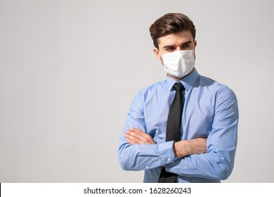 is time to protect all the time. elegant man wearing a mouth protection to prevent getting sick at work or on the way to work