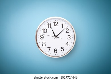 Time punctual second minute hour. Large clock on a blue wall. The concept of time.