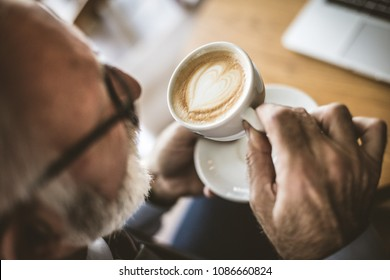 Time for relax. Senior businessman with a cup of coffee. Close up image.