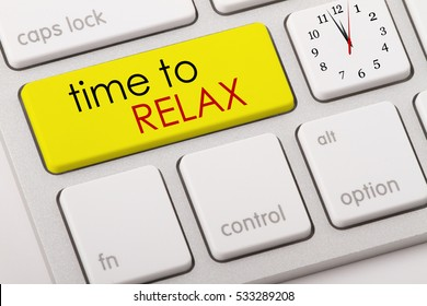 Time to relax word written on computer keyboard.