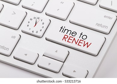 Time to renew word written on computer keyboard.