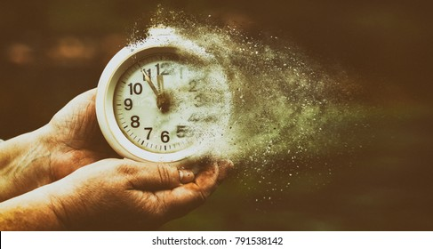 time is running out. concept. clock in old female hands.