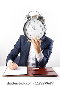 Time is running out for this businessman sitting and working at his desk