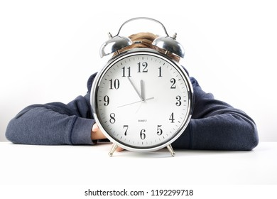 Time is running out for this tired student hanging on his desk