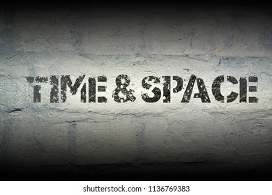 time and space stencil print on the grunge white brick wall