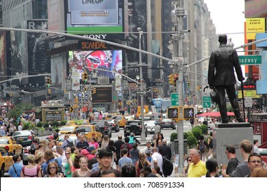 TIME SQUARE, NEW YORK CITY - JULY 15, 2012: Crowd Tourists Walking and Traffic Jam. Busy Situation. George M. Cohan Statue.