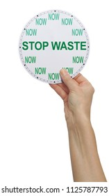 It is TIME to STOP WASTE - female hand holding a clock face that says NOW in place of the numbers and with STOP WASTE across the middle isolated on a white background