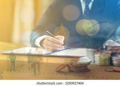 Time to success in business - Double exposure of business man signing business agreement with clock, city life and coins money