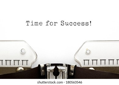 Time For Success printed on an old typewriter.